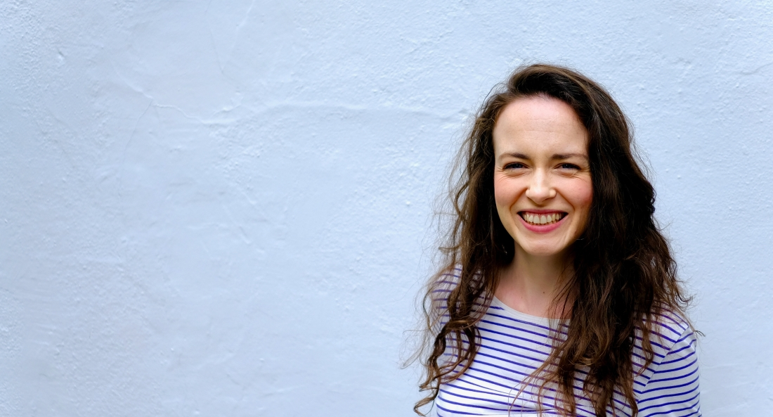 Health and lifestyle journalist Laura Day stands against a white background