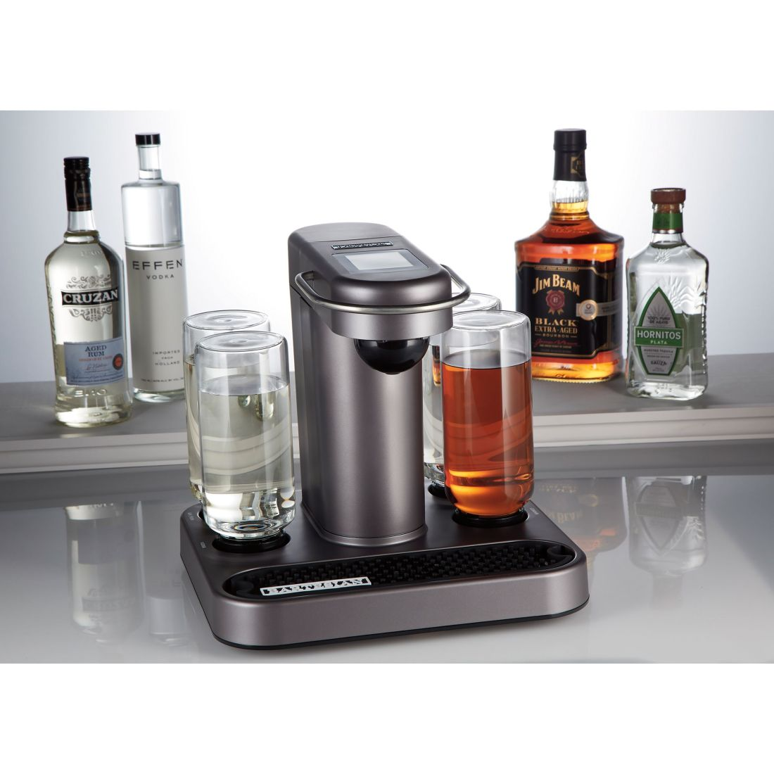 The picture shows the Bartesian and four bottles of alcohol placed behind it